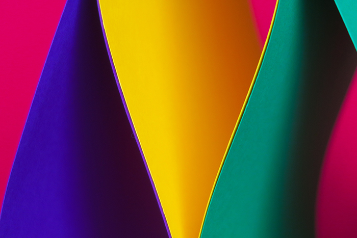 Brightly colored abstract photo made using sheets of colored paper