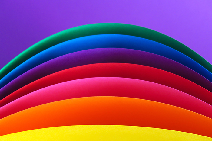 An abstract composition of rainbow colored paper - creative abstract photos ideas
