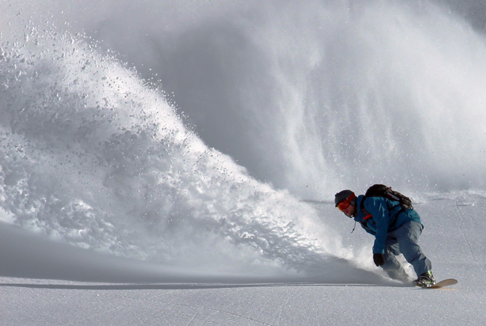Action shot of a snowboarder, shot using a fast shutter speed