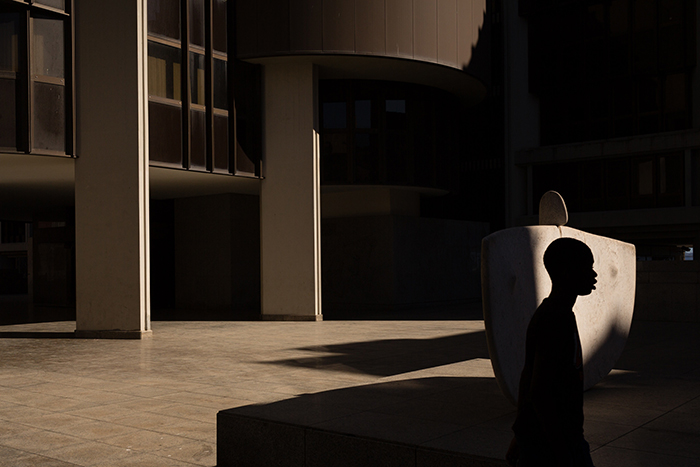 Atmospheric portrait of a silhouette of a person in a shadowy interior - fine art photography mistakes