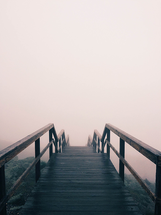 Atmospheric portrait of a wooden bridge disappearing into mist - fine art photography mistakes