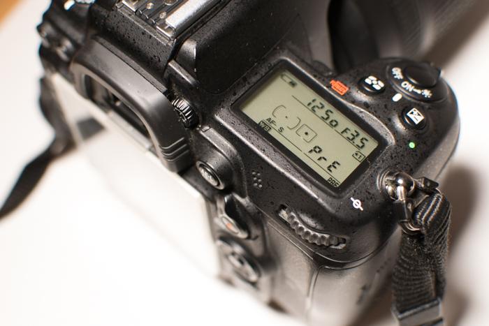 A close up of setting white balance on a Nikon camera