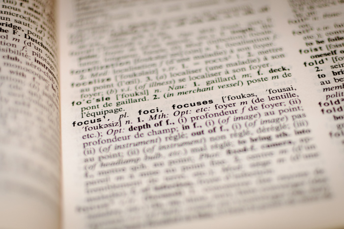 A close up of a dictionary with sharp focus on the entry for 'focus'