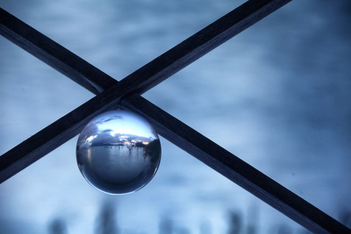 A creative shot of a minimalist landscape landscape within a crystal ball.