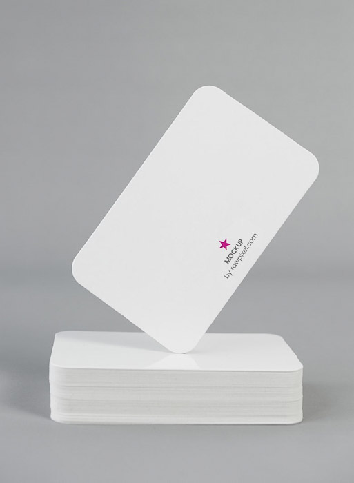 A stack of white photography business cards - marketing and branding photography tips