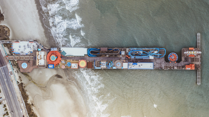 An aerial view of a pier and coastal road - expert photography quiz questions