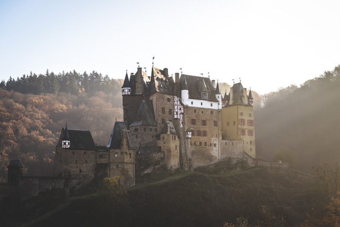 Dreamy shot of a castle in a mountainous landscape - expert photography quiz questions