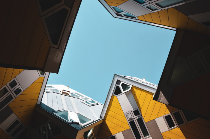 The roofs of interestingly designed yellow buildings shot from an unusual angle - photography quiz
