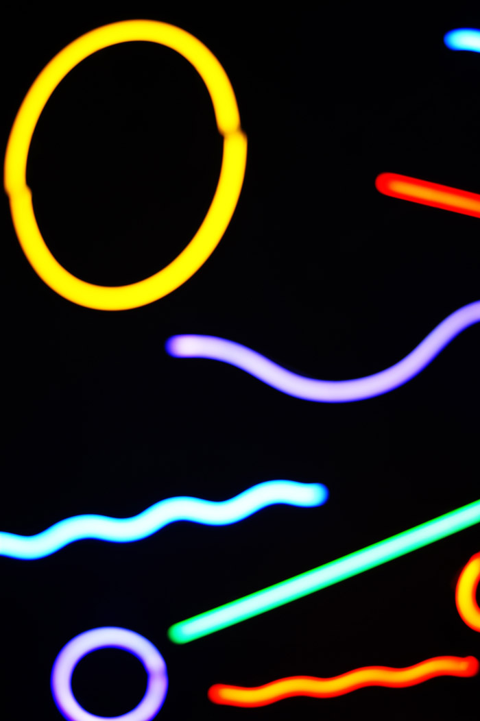 Colored neon shapes against a black background - good abstract photography