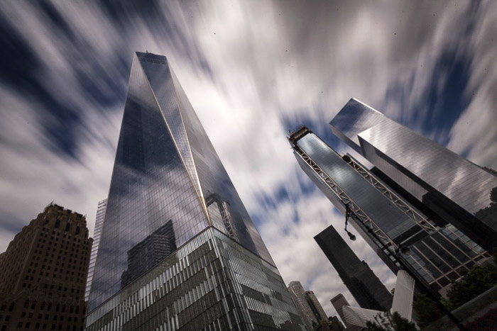 Clouds moving across the sky at the One World Trade Centre in New York, shot using slow shutter speed