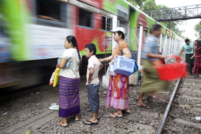 People waiting for the train which is passing with creative motion blur by using a slow shutter speed