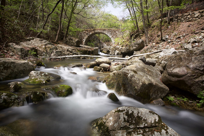 a long exposure of moving water shot during the day using a slow shutter speed