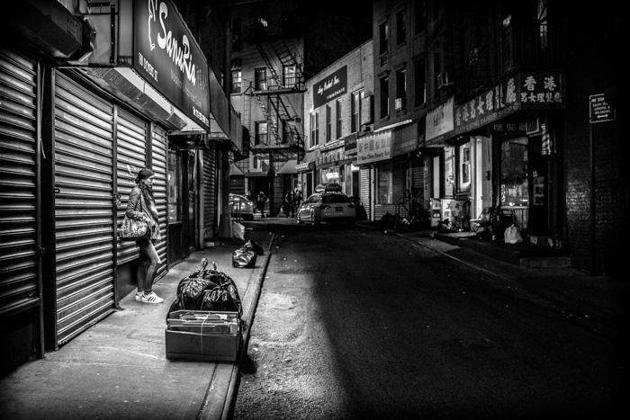 A monotone street scene at night
