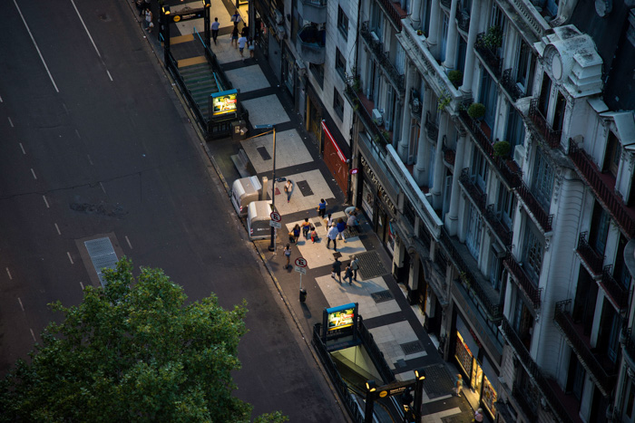 An overhead shot of a city street scene at night shot with a tilt shift lens