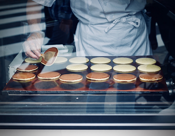 A close up portrait of a chef preparing food - cool travel pictures of japan