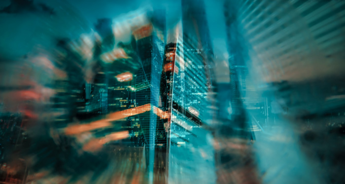 A creatively blurry photo of a cityscape in low light shot using a zoom lens