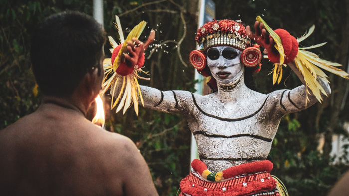 A travel photography portrait of men in tribal dress shot using a zoom lens