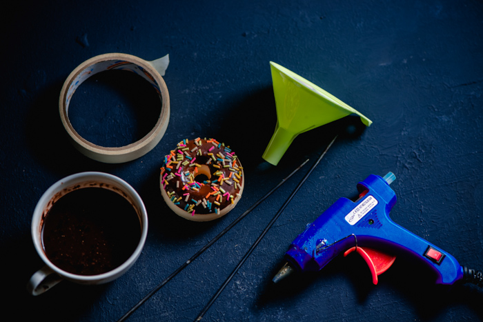 A flat lay of props and tools for creating chocolate plash food photography