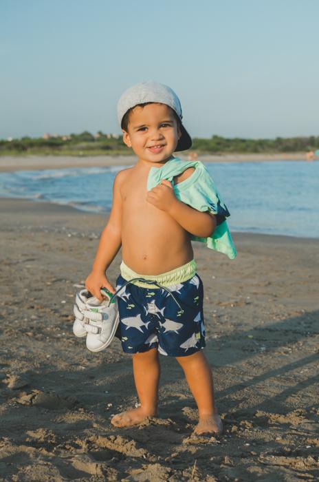 A sweet portrait of a little boy on a beach