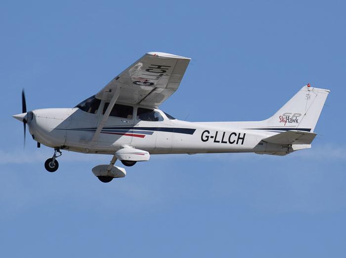 A Cessna 172 Skyhawk aircraft in mid flight - abstract aerial landscape photos