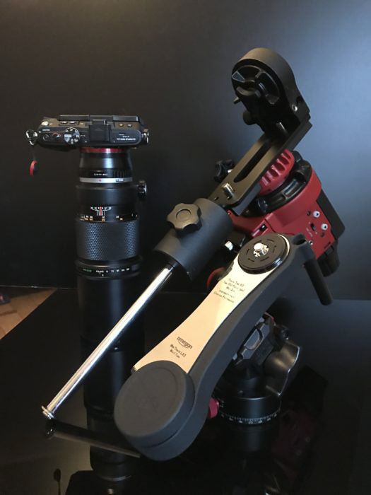 The Star Adventurer in the full astrophotography configuration (in red). Next to it, we have the Minitrack LX2 and my Olympus EPL-6 camera on Olympus Zuiko OM 300 f/4.5 telephoto lens.