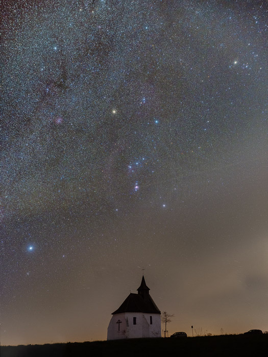 An impressive star filled sky over a house at night