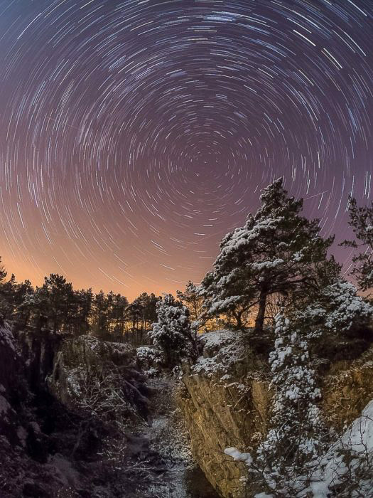 compelling star trails over a stunning landscape - astrophotography tools