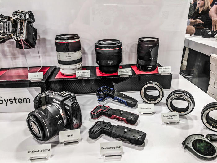 A display case featuring the Canon EOS system products including the new Canon RF lenses for mirrorless camera