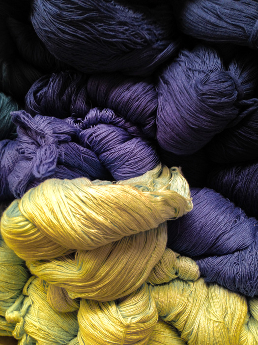 Yellow and purple balls of wool