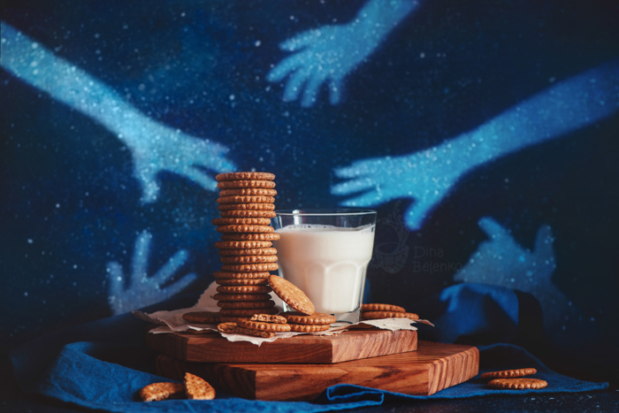 Creative food still life including milk and cookies