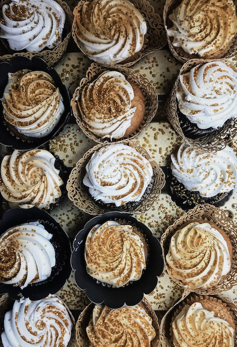 Overhead cupcakes photography of brown and white frosted cakes
