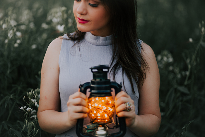 outdoor portrait of a female model holding a lantern - fairy light photography