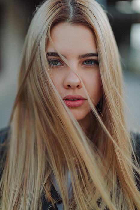 A stunning portrait of a blond female model - female face portrait