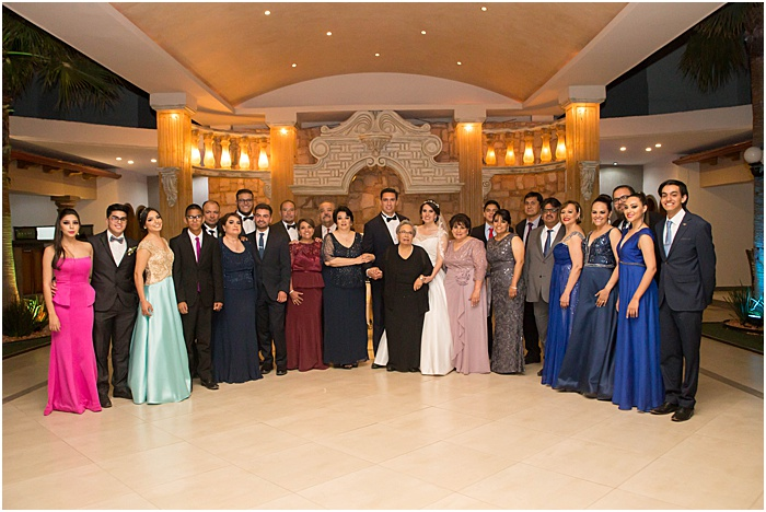 A group photo of a wedding party posing indoors - wedding flash photography