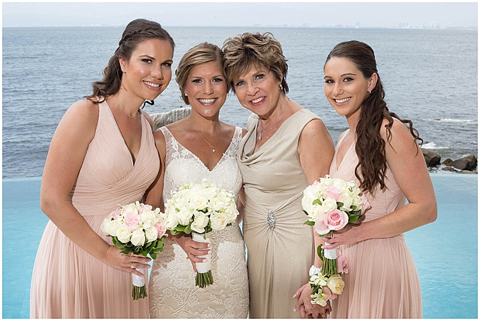 A wedding portrait of the bride and bridesmaids posing outdoors - wedding flash photography