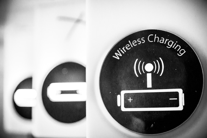 A black and white shot of a sign indicating wireless charging