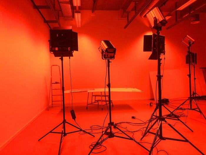 Studio lighting setup in orange light