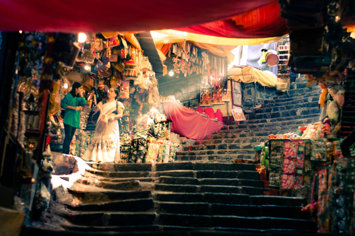 Atmospheric travel photography shot of an open air market shot with a mirrorless camera