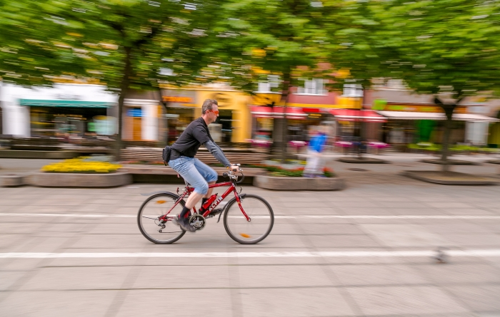 man on a bicycle with blurred background