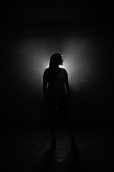 Film noir photography portrait of a female model in monochrome