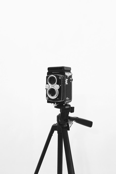 A vintage film camera on a tripod - photography business equipment