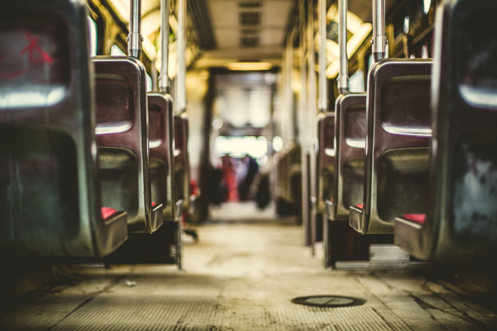 A photo of the interior of a bus shot using selective focus