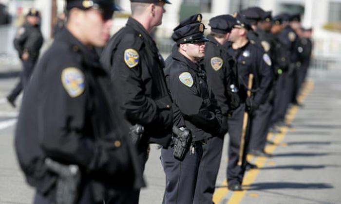 A line of policemen shot using selective focus