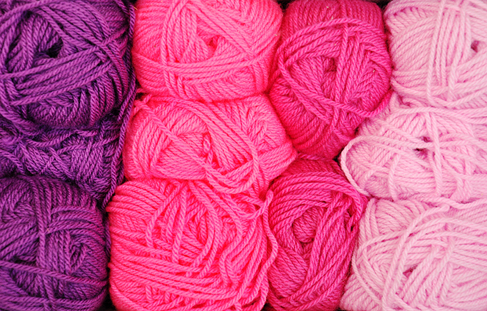 Lines of pink and purple balls of wool - using vibrant colors in photography