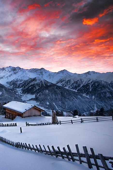 A stunning winter landscape at sunset - winter photography ideas