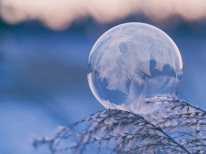 Stunning crystal ball photo in the snow - winter photography ideas