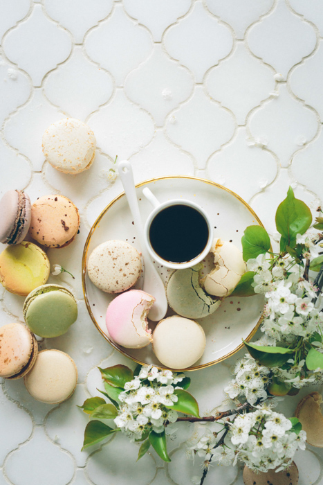 Cute food themed still life featuring macaroons, coffee and flowers - spring photography ideas