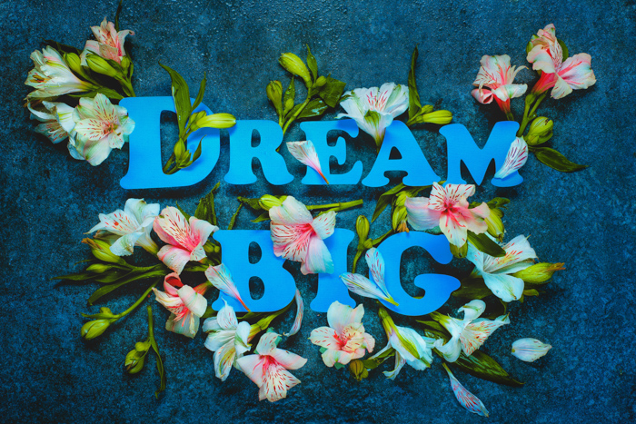 Cool still life featuring flowers and typography - spring photography ideas