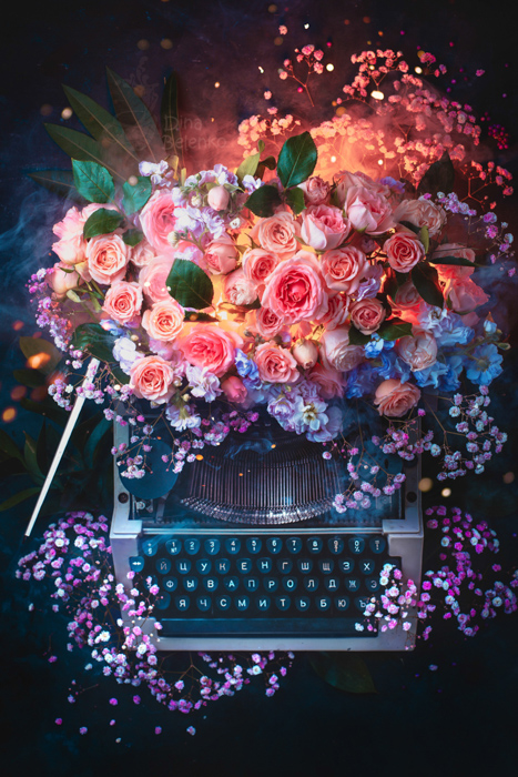Creative still life of a flower covered typewriter shot with a speedlight