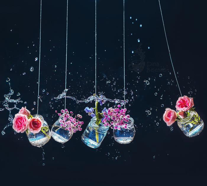Creative floral themed still life of flowers in glass jars shot with a speedlight
